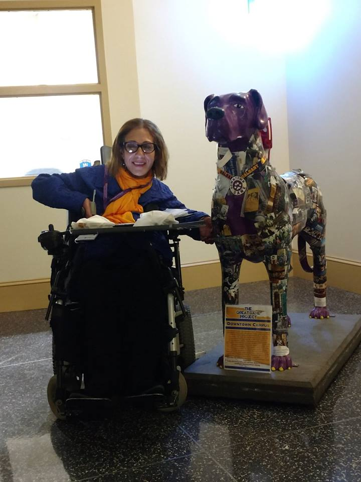 Sheri at the University of Albany with a statue of a great dane, 11-18.