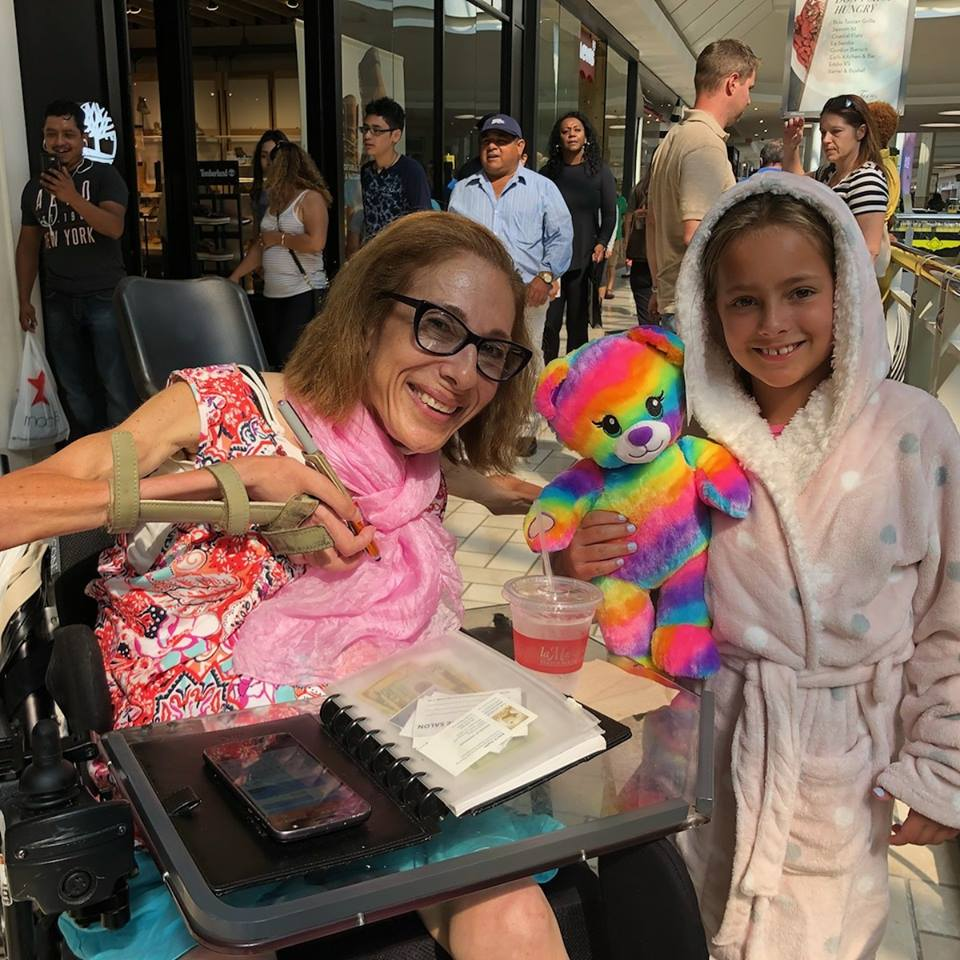 Always fun running into friends at Tysons Corner mall (Marley just came from Build-A-Bear), 8-18.
