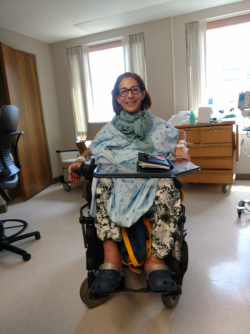 "Sheri looking ""Happy on Wheels"" the day after surgery, 6-18."