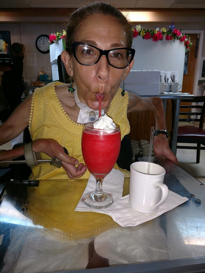 Sheri enjoying a strawberry daiquiri at Robin Hood in Rehoboth Beach, DE, 9-18.