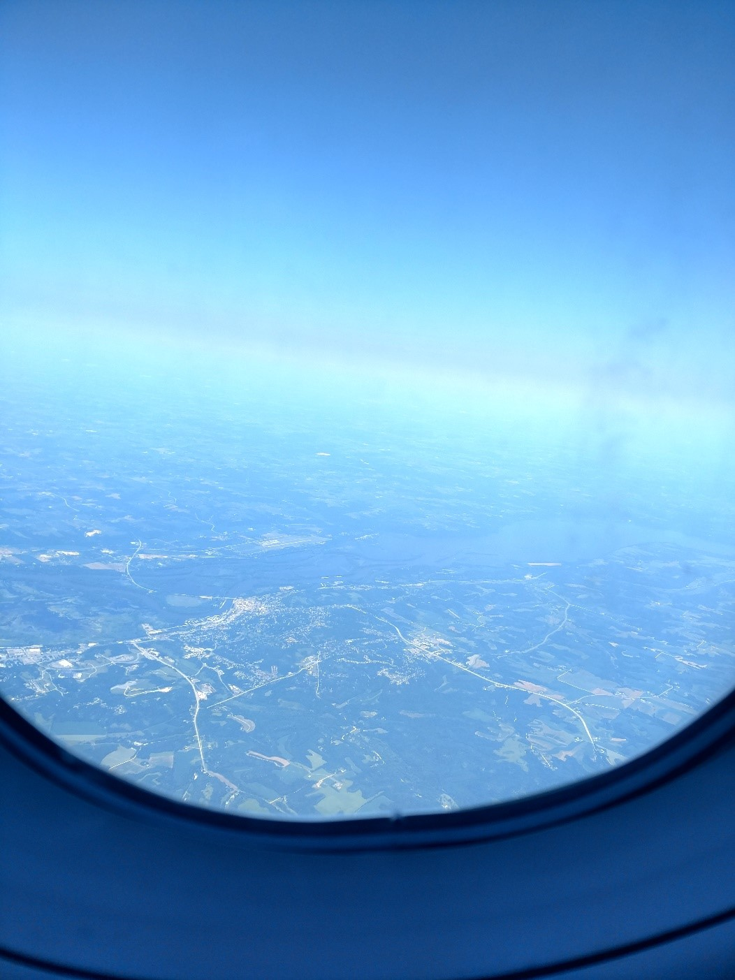 View out the window of the plane taking off from Minneapolis, 7-18.