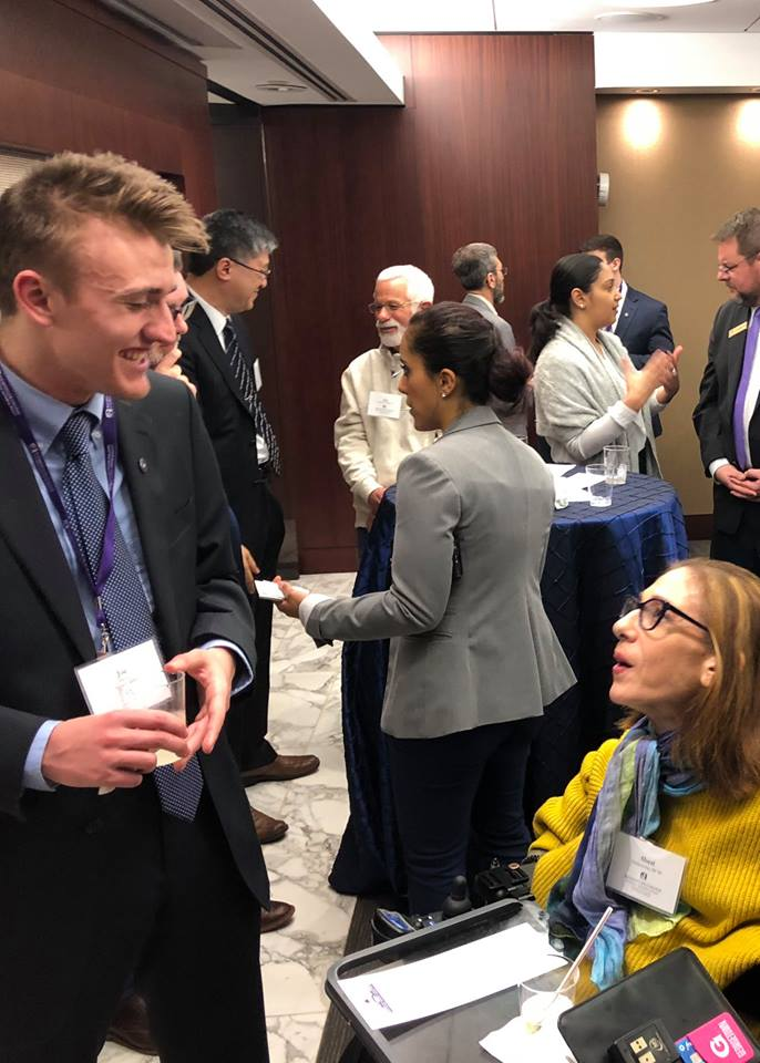 Speaking with UAlbany Semester in Washington student Joseph Bryant at a UAlbany Alumni Reception, 2018.