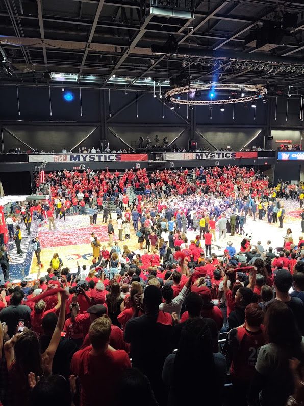Fans swarm the court as the Washington Mystics win the WNBA title,10-19.