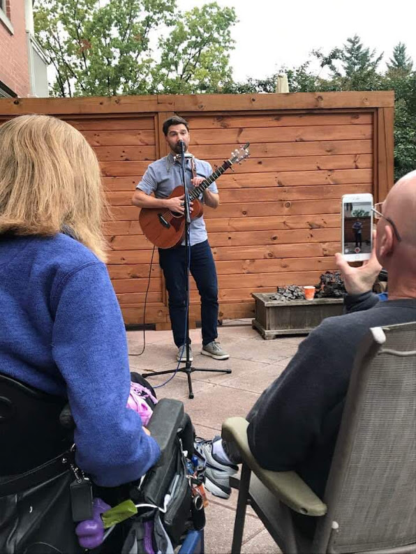 Musician Eli Lev, performing on the terrace for family and friends at Happy on Wheels' condo, 10-19.