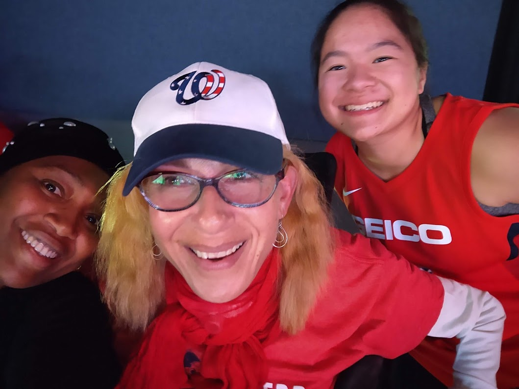 A happy crew; Halema (l), Sheri, and MeiLi (r), at game 5 of the Washington Mystics WNBA Finals, 10-19.