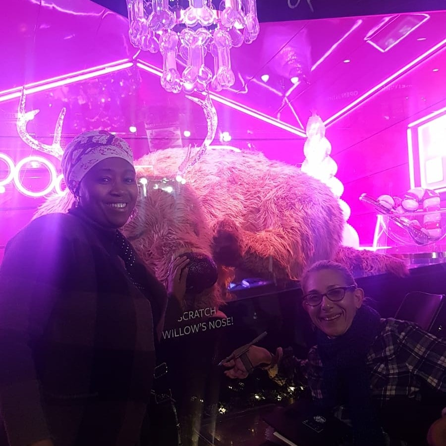 Sheri and one of her aides, Halema, in front of the holiday lights at Macy's in Manhattan, 11-19.