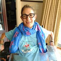 Sheri wearing her official T-shirt from the Marine Science and Adaptive Scuba Camp for kids with disabilities along with a turtle scarf. Happy on Wheels was a sponsor, 8-19.