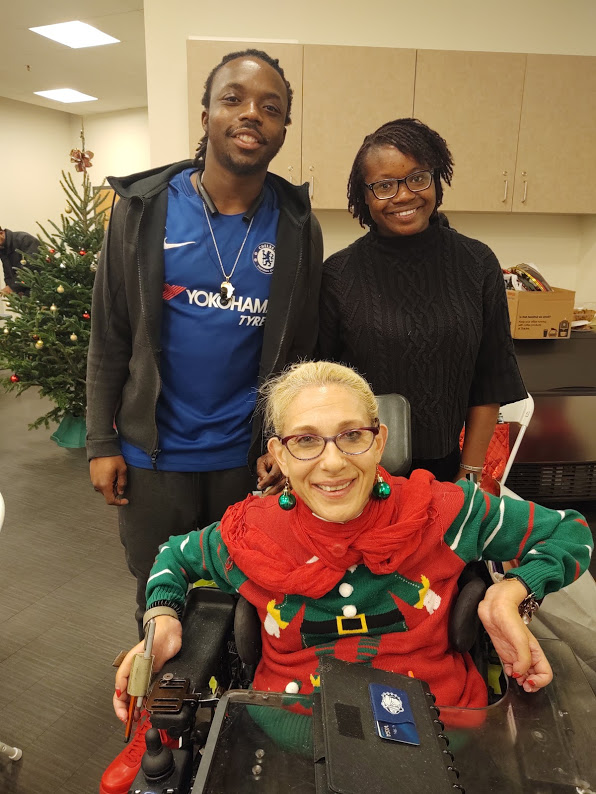 Sheri and former interns Derek and Rah at a Thelma Jones breast cancer support meeting holiday party. 12-19.
