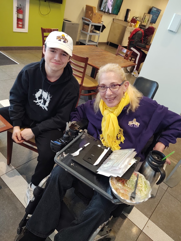 Sheri with friend Amy's son having lunch at UAlbany, 12-19.