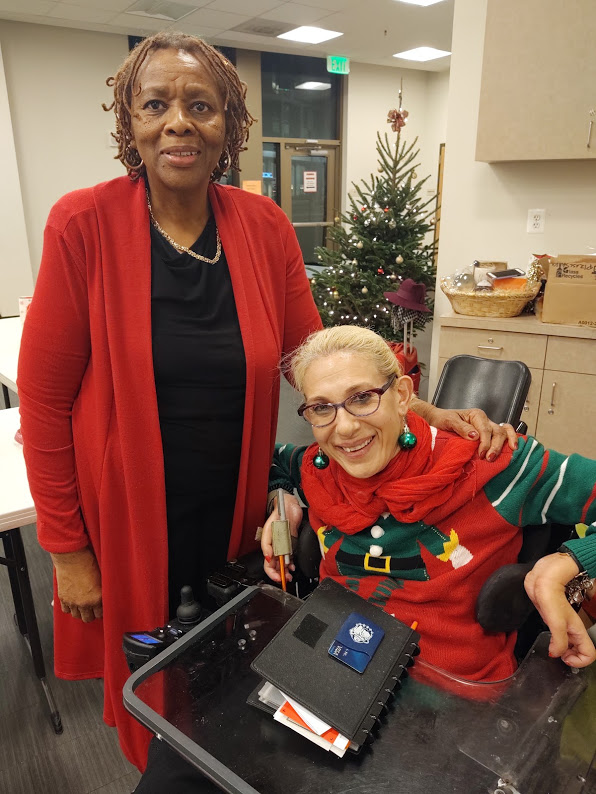 Sheri and Thelma in a celebratory mood at the Thelma Jones breast cancer support meeting holiday party, 12-19.