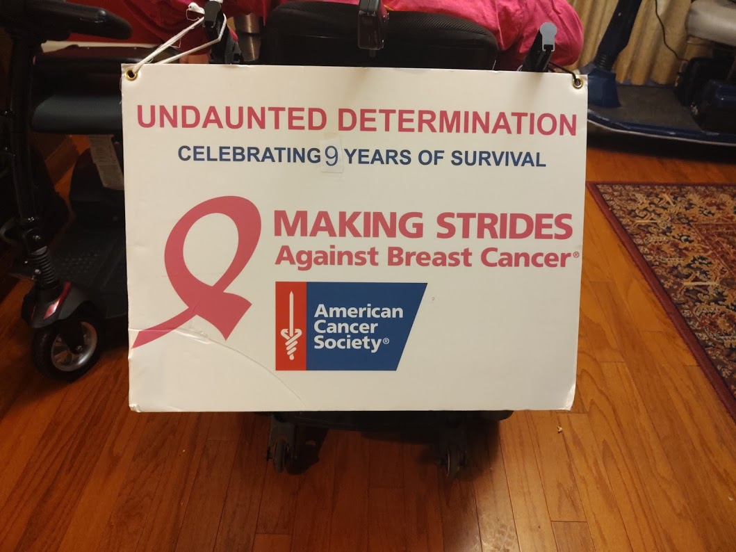 The annual sign on the back of Sheri's chair, team Undaunted Determination, Celebrating 9 Years of Survival, 10-19.