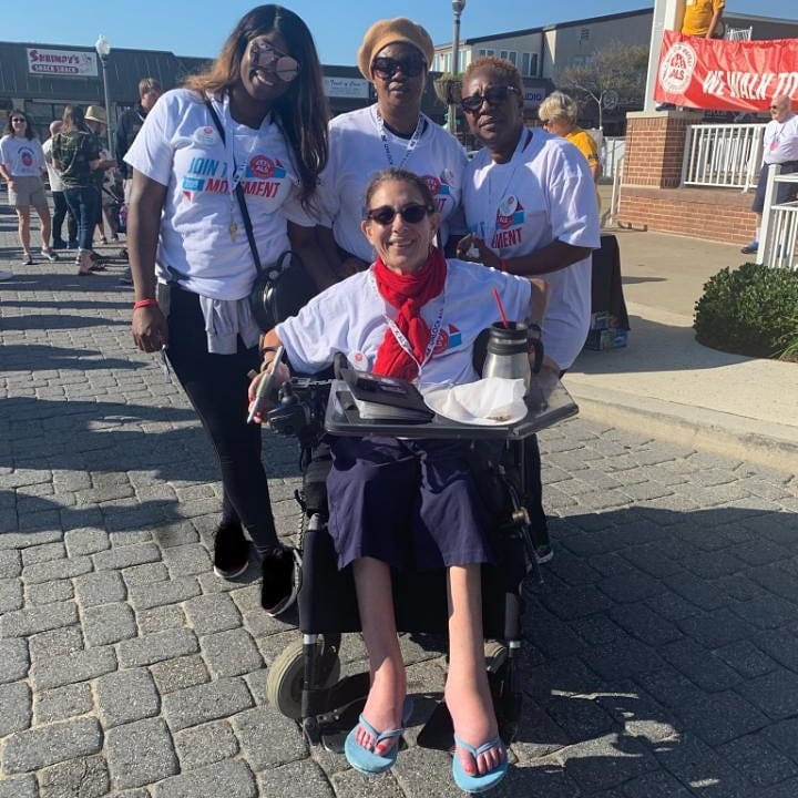 Sheri and her aides, Amy and Fatima, and Fatima's daughter Kadie, participating at the annual walk to raise money for ALS, 9-19.