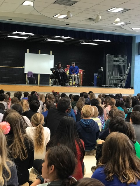 Happy on Wheels speaking to and answering questions from students at Glebe Elementary in Arlington, about life when using a wheelchair, 3-19.