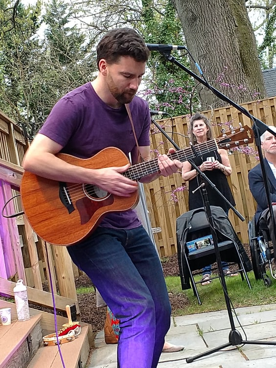 Local musician Eli Lev, playing at good friend's backyard house party. We were lucky it was a beautiful evening and the rain held off, 4-19.