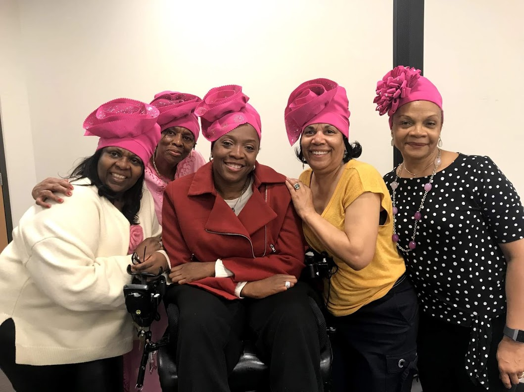 Caption: Some of the great ladies at the Thelma D. Jones Breast Cancer Fund, breast cancer support group meeting, showing off their new beautiful pink headwraps. Thelma is second from the left. The great DJ Regina is in the middle in the red jacket, 4-19.