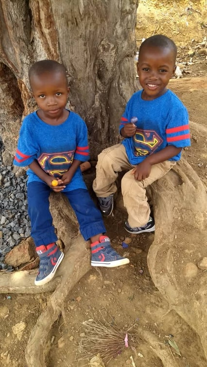 Good friends Charlie (l) and Justice (r) just relaxing at home in Sierra Leone, 4-19.
