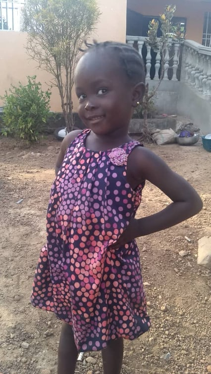 Aminata posing for the camera at home in Sierra Leone, 4-19.