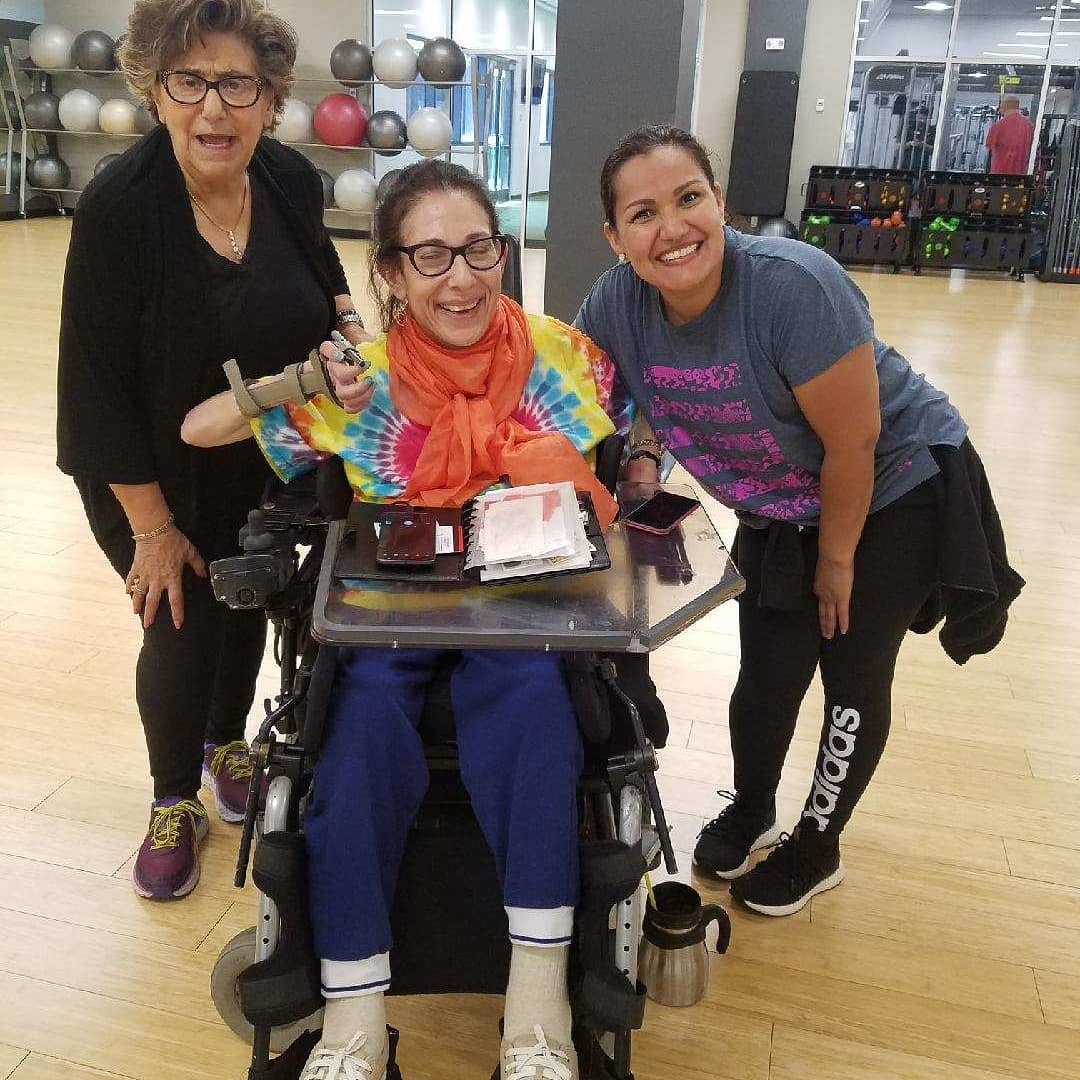 Sheri with her new Zumba teacher Lizeth (r) and classmate who is in her 80s (l), 5-19.