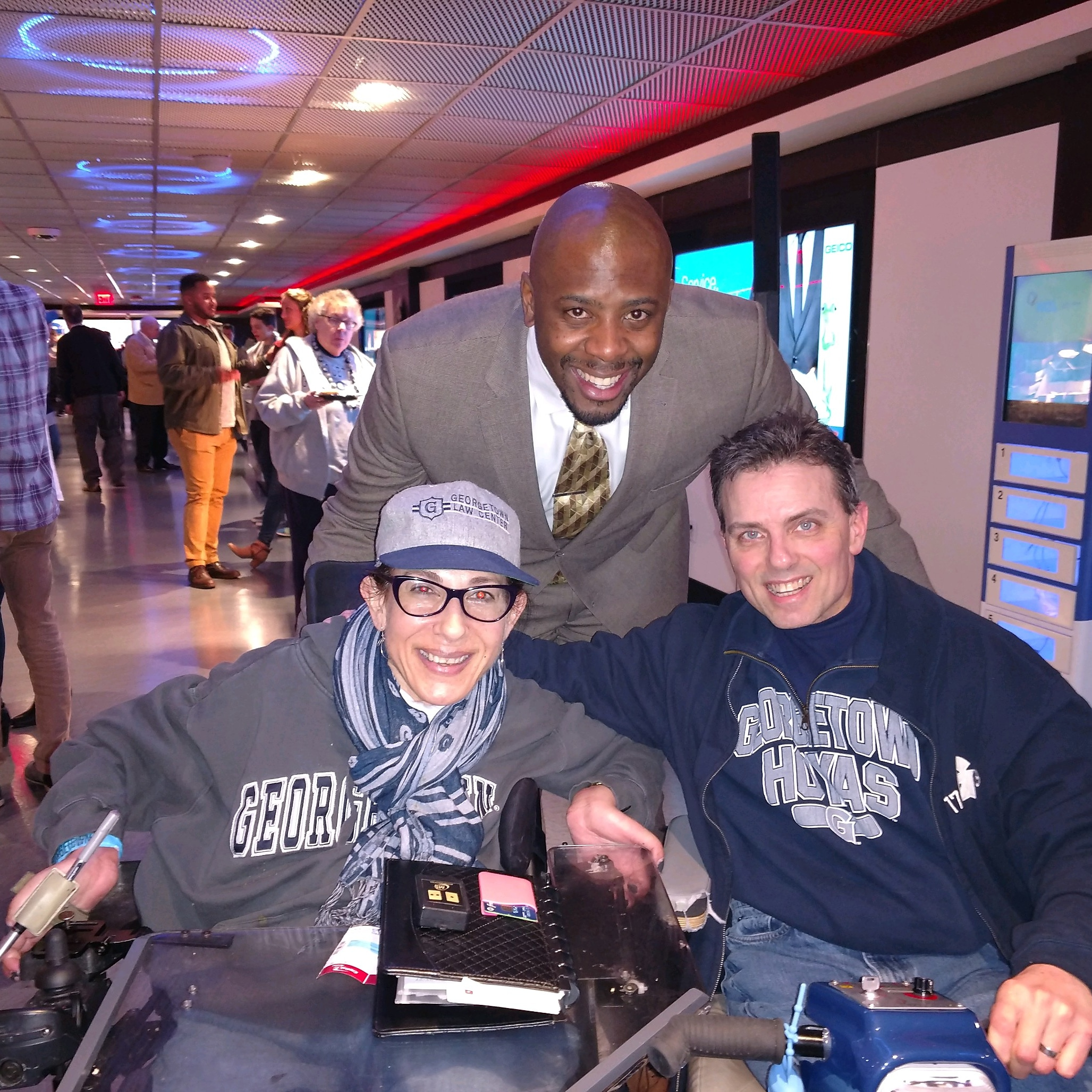 Happy on Wheels with Patrick Ewing Jr. at a reception before the final Georgetown men's basketball home game of the season, 3-19.