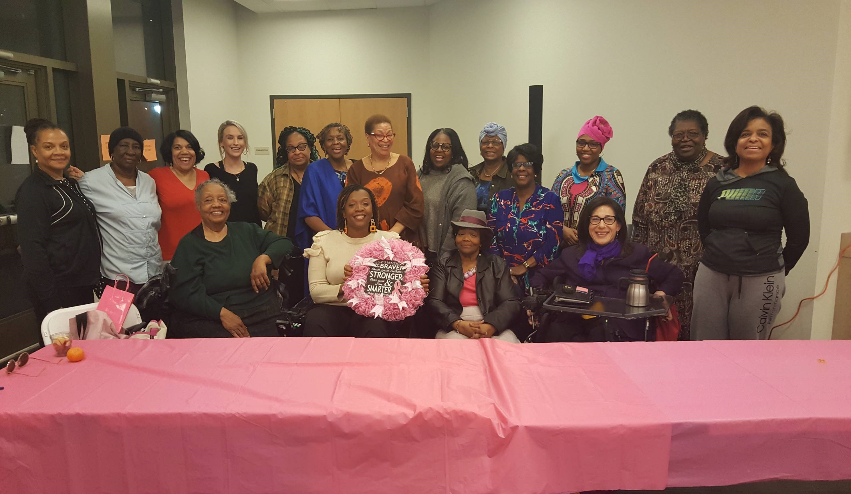 ": Group photo at the Thelma D. Jones Breast Cancer Fund Support Group Celebration of Women's History Month (Thelma, back row Middle with Blue Scarf on Her Shoulder) with guest Speaker Dr. Julianne Malveaux! (sic, back row middle with orange and brown outfit) who spoke about the ""Economics of Breast Cancer,"" 3-19."