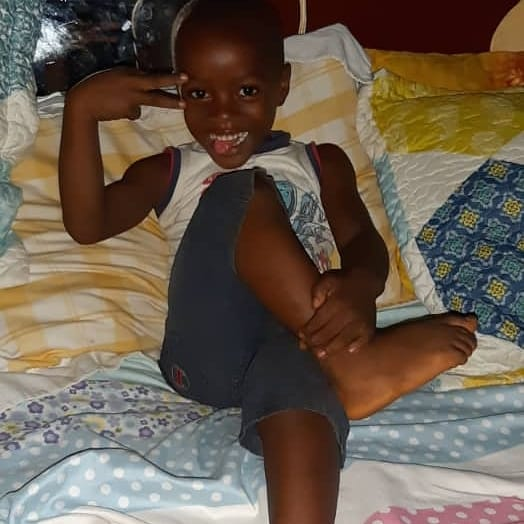 "Happy on Wheels  ""adopted"" son Charlie relaxing and feeling good in Sierra Leone, 3-20."