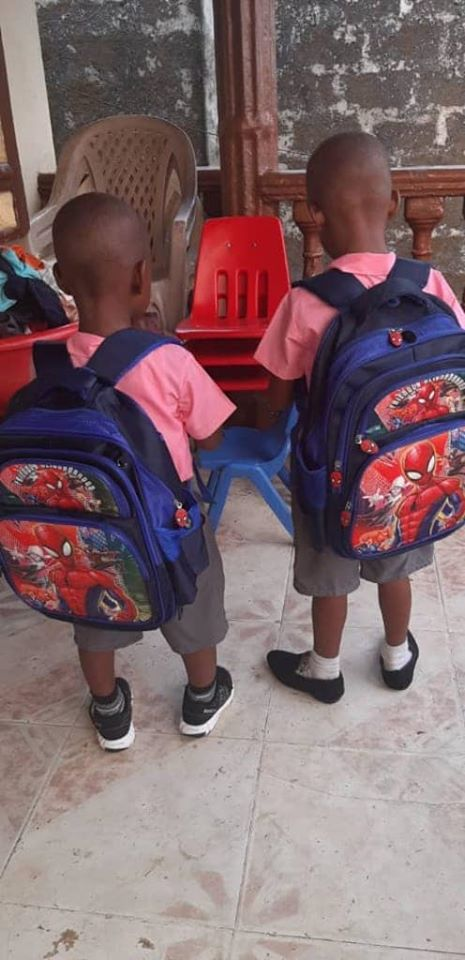 "Charlie and his ""brother"" Justice with their matching backpacks, getting ready to go off to their new school, 1-20."
