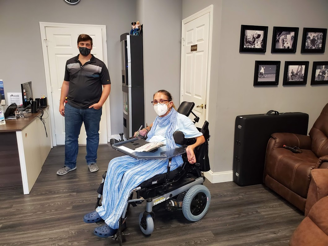 Sheri with her essential worker wheelchair technician after getting her new tires, 10-20.