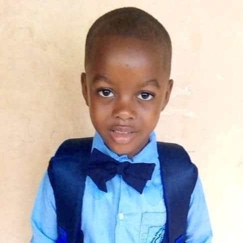 """Charlie, our """"adopted"""" son, dressed in his uniform and ready for his first day of a new school in Sierra Leone, Africa, 10-20."""