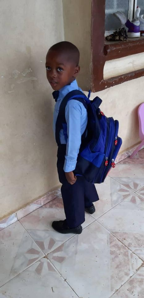 Charlie modeling his superhero backpack and complete uniform as he heads off to start school, 10-20.