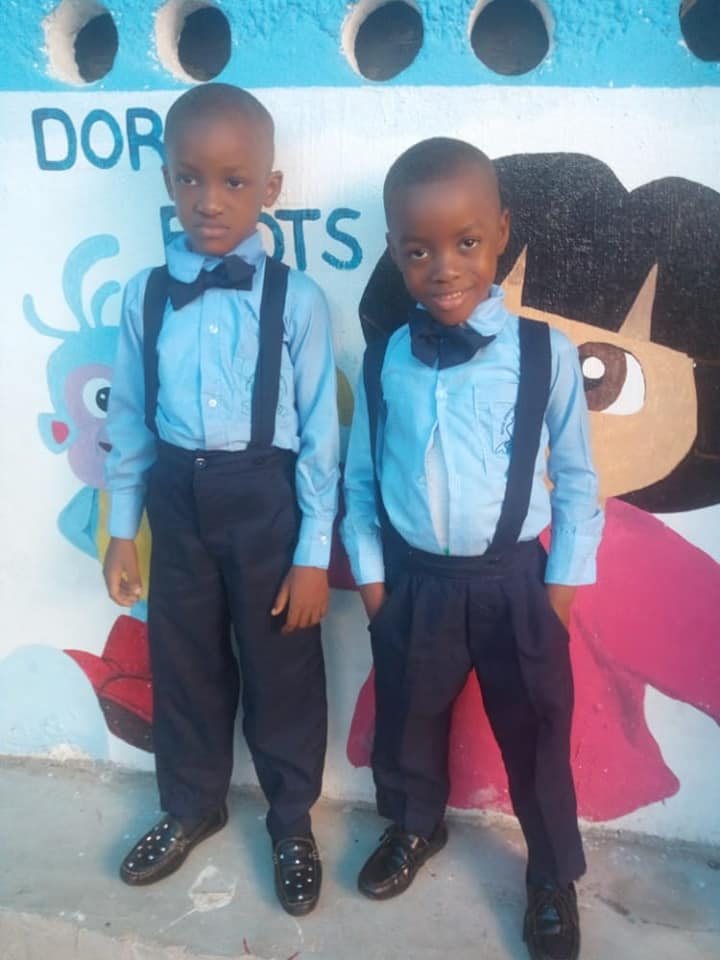 Charlie and his 'brother' Molai dressed in their school uniforms, 12-20.