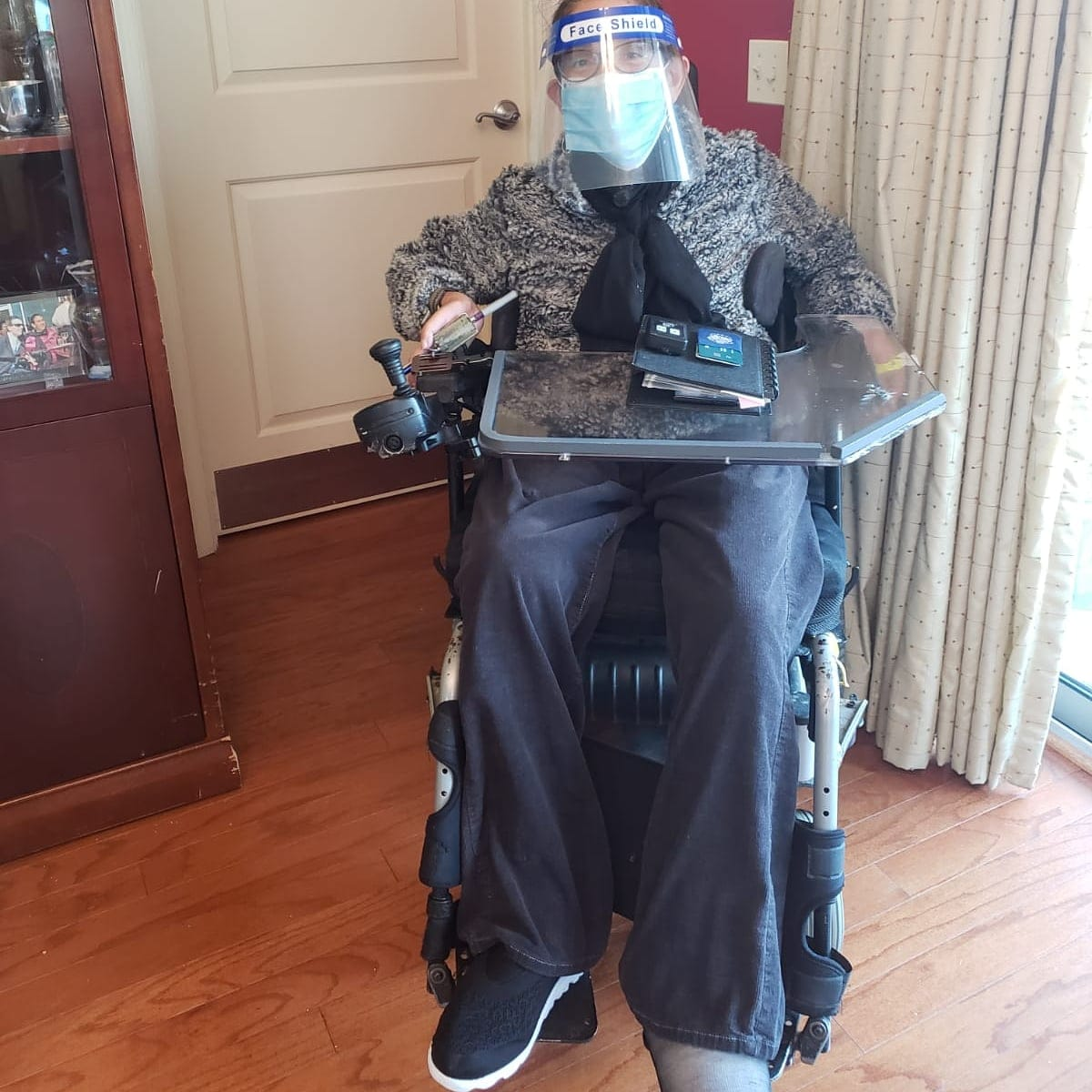 Sheri ready to venture out to the lymphedema clinic fully protected with her shield and mask, 12-20.