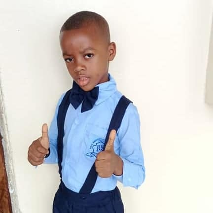 """Charlie giving """"thumbs up"""" dressed in his formal school uniform, 12-20."""
