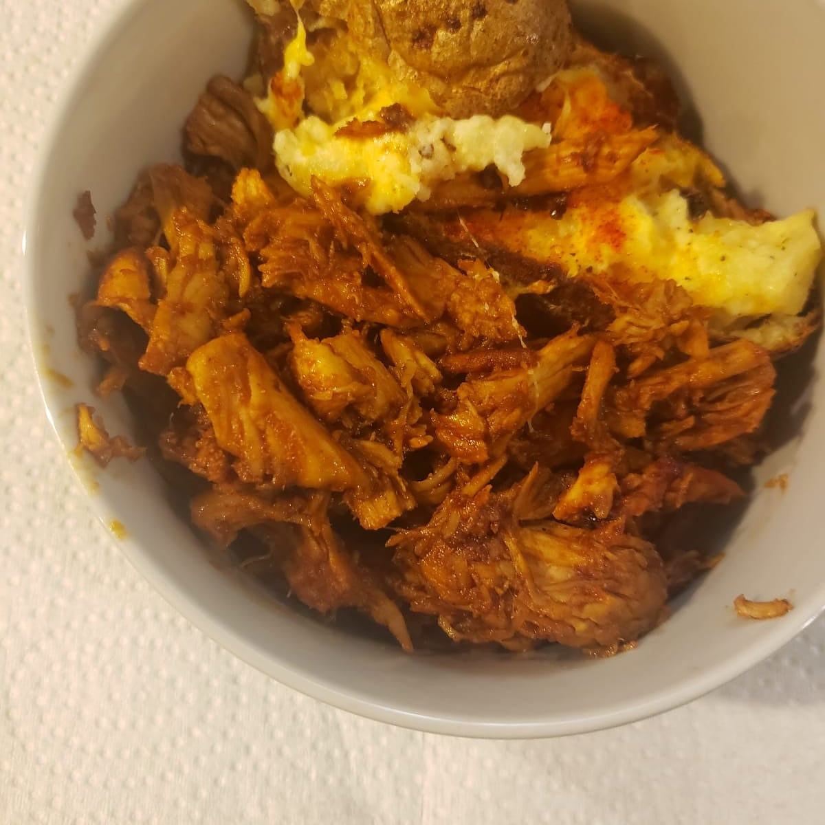 Homemade pulled chicken barbecue with a twice baked potato, 3-21.