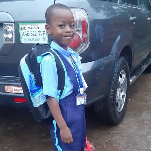 Charlie is ready for the 1st day of school in Sierra Leone, Africa, 9-21.