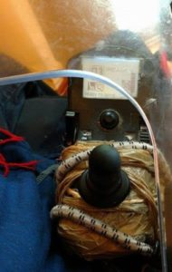 joystick held together with duct tape and bungee cord