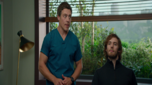 """Still from """"Me Before You"""" showing Will and his caregiver Nathan."""