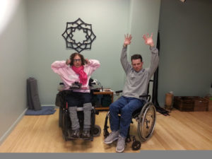 Wheelchair users doing yoga.