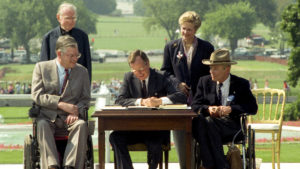 The signing of the ADA in 1990.