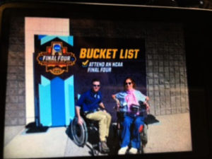Happy on Wheels under a Bucket List sign