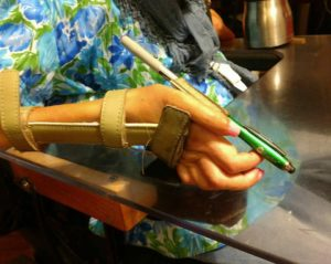 "Sheri's splint with an ""invented"" pen/stylus holder"