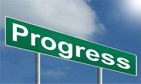 Sign with the word Progress.