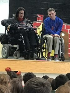 Happy on Wheels speaking at an elementary school
