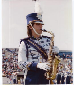 Tony in formation in marching band at JMU