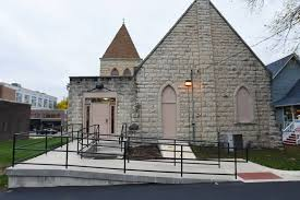 Photo of a wheelchair ramp leading to a church.