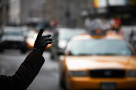 Photo of someone hailing a taxi