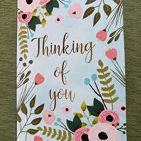 "A card that says, 'Thinking of You"" on the front."