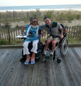 Sheri and Tony on the boardwalk at the beach.