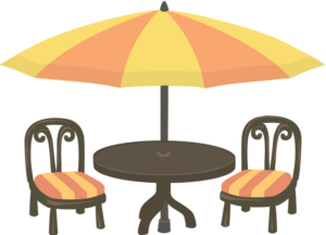 Outdoor cafe table with an umbrella and two empty chairs.