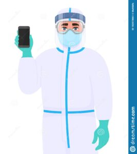 A doctor wearing protective gear and holding a cellphone