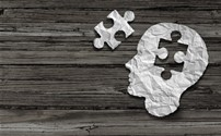 Picture of a person's head wuth a puzzle piece missing and nthe puzzle piece is next to the head.